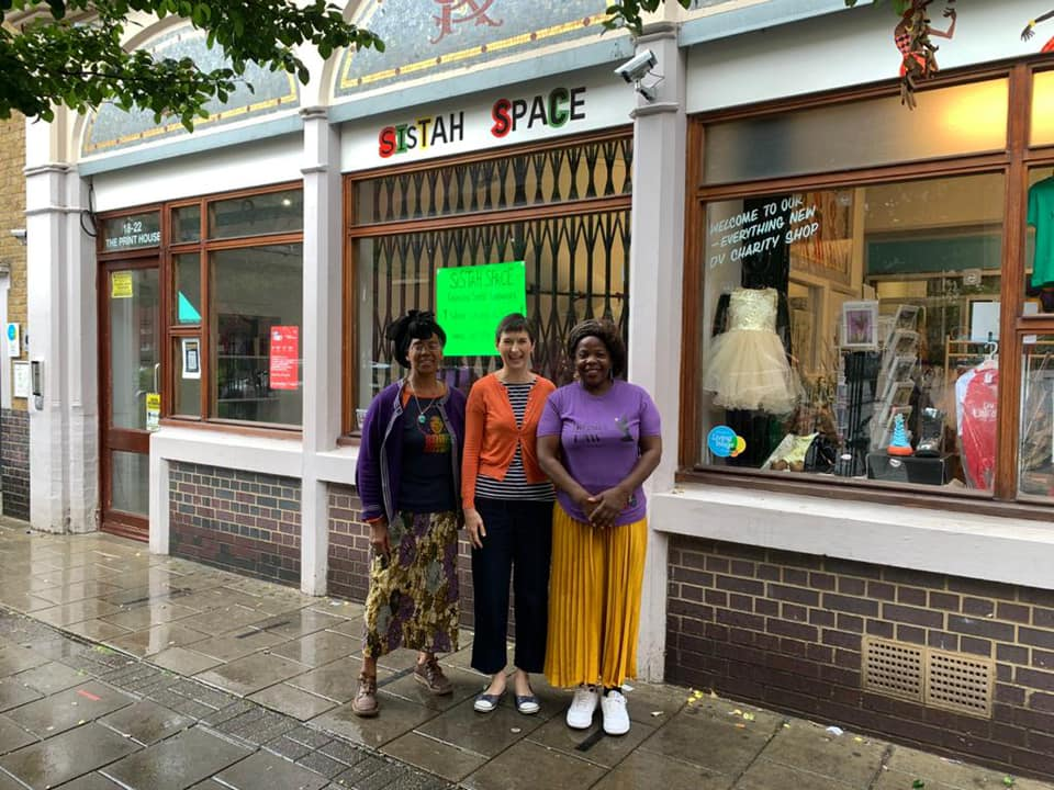 Caroline with the volunteers at Sistah Space's charity shop